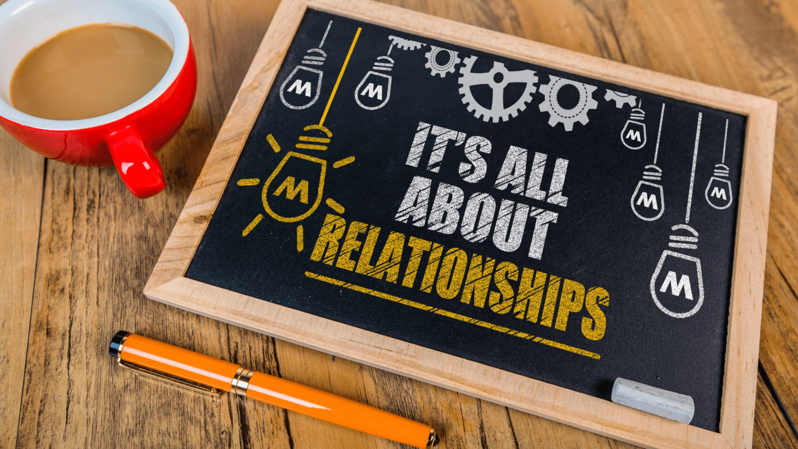 """chalkboard sign that says """"it's all about relationships!"""" and a cup of coffee"""