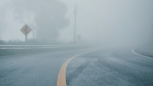 a road covered in fog representing how power agents can help lift the fog
