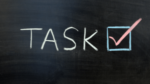 chalkboard with the word 'task' and a checkmark next to it